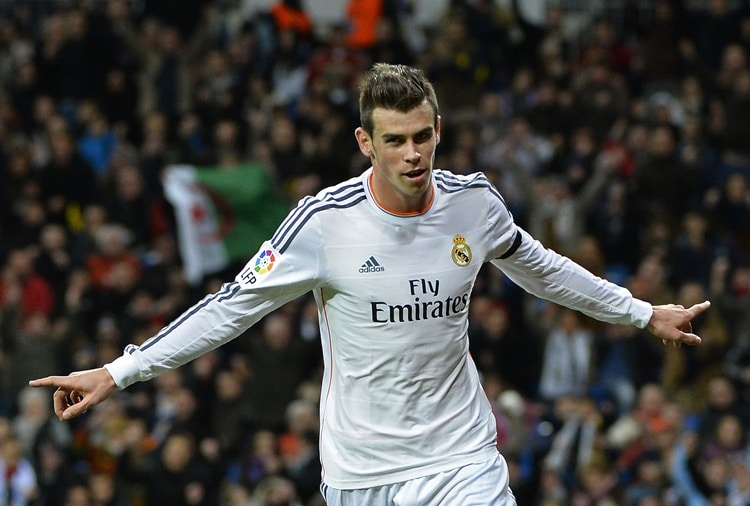 Real Madrid's Welsh forward Gareth Bale celebrates after scoring a goal during the Spanish league football match Real Madrid CF vs Real Valladolid CF at the Santiago Bernabeu stadium in Madrid on November 30, 2013. AFP PHOTO/ GERARD JULIEN (Photo credit should read GERARD JULIEN/AFP/Getty Images)