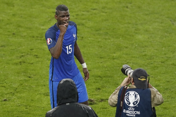 France's Paul Pogba celebrates at the end of their Euro 2016 quarterfinal soccer match between France and Iceland, at the Stade de France in Saint-Denis, north of Paris, France, Sunday, July 3, 2016. France won 5-2. (AP Photo/Michael Sohn) ORG XMIT: VC143