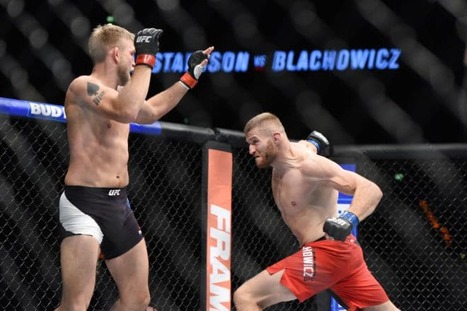 Sep 3, 2016; Hamburg, Germany; Alexander Gustafsson (red gloves) competes against Jan Blachowicz (blue gloves) during UFC Fight Night at Barclaycard Arena. Mandatory Credit: Per Haljestam-USA TODAY Sports