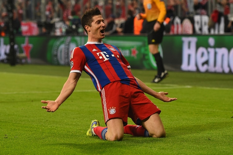 MUNICH, GERMANY - APRIL 21: Robert Lewandowski of Bayern Muenchen celebrates scoring the fifth goal during the UEFA Champions League Quarter Final Second Leg match between FC Bayern Muenchen and FC Porto at Allianz Arena on April 21, 2015 in Munich, Germany. (Photo by Dennis Grombkowski/Bongarts/Getty Images)